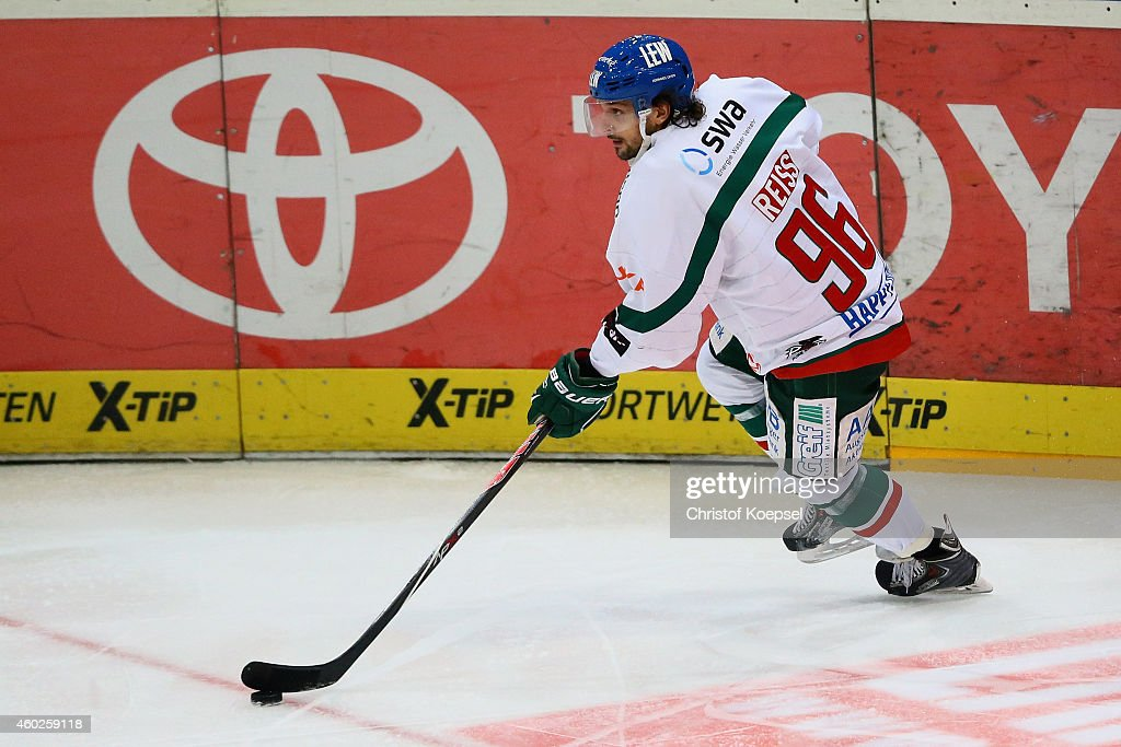 Andre Reiss of Augsburg leads the puck during the DEL Ice Hockey match between Koelner Haie and Augsburger Panther at Lanxess Arena on December 10...