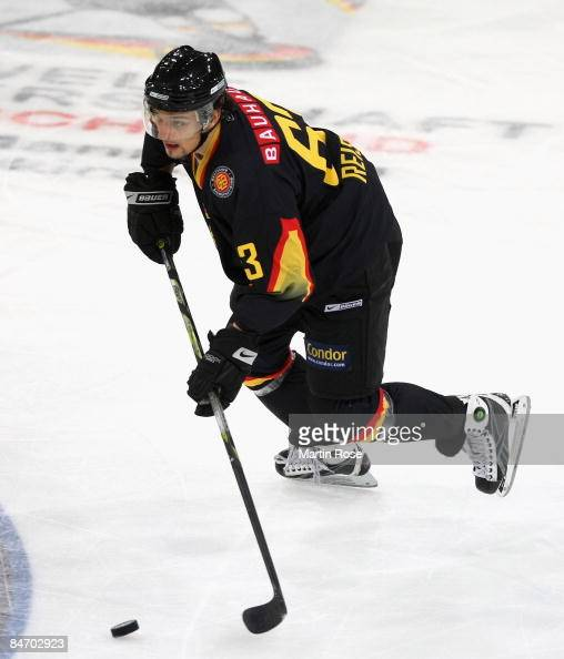 Andre Reiss of Germany runs with the puck during the Vancouver 2010 Qualifier match between Germany and Slovenia at the TUI Arena on February 8 2009...