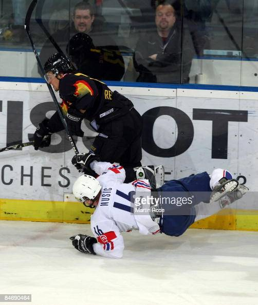 Andre Reiss of Germany tackles Ales Music os Slovenia at the board during the Vancouver 2010 Qualifier match between Germany and Slovenia at the TUI...