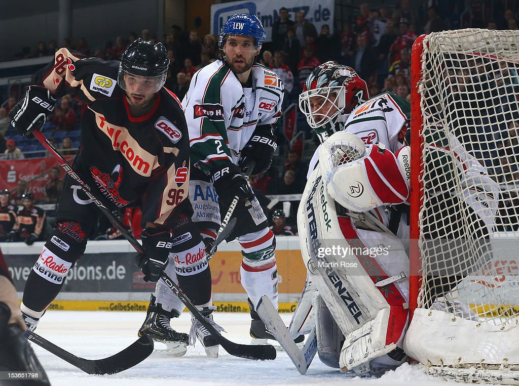 Andre Reiss of Hannover and Daryl Boyle of Augsburg battle for position in front of the net during the DEL match between Hannover Scorpions and...
