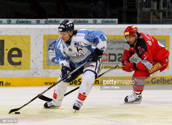 Andre Reiss of Hannover and Eric Meloche of Straubing battle for the puck during the DEL match between Hannover Scorpions and Straubing Tigers at the...