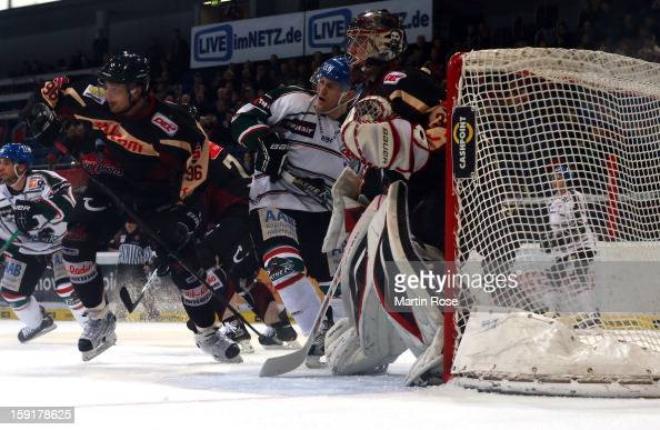 Andre Reiss of Hannover battles for position with Sergio Somma of Augsburg battle for the puck during the DEL match between Hannover Scorpions and...
