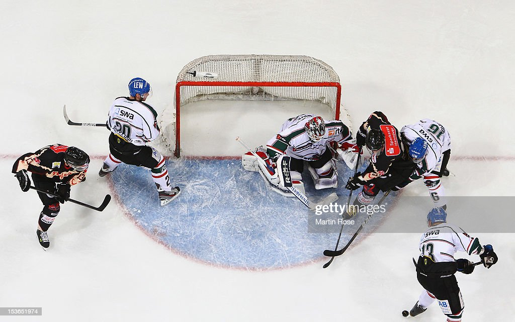 Andre Reiss of Hannover fails to score over Patrick Ehelechner goaltender of Augsburg during the DEL match between Hannover Scorpions and Augsburger...