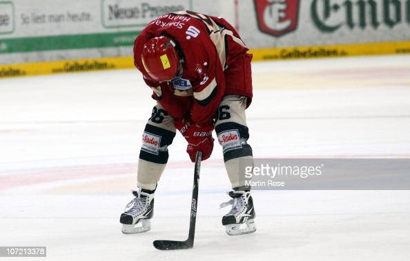 Andre Reiss of Hannover looks dejected after losing the DEL match between Hannover Scorpions and Thomas Sabo Ice Tigers at the TUI Arena on November...