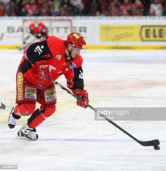 Andre Reiss of Hannover runs with the puck during the DEL Bundesliga game between Hanover Scorpions and ERC Ingolstadt at the TUI Arena on January 20...