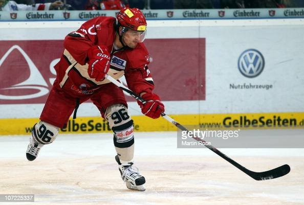 Andre Reiss of Hannover runs with the puck during the DEL match between Hannover Scorpions and Thomas Sabo Ice Tigers at the TUI Arena on November 30...