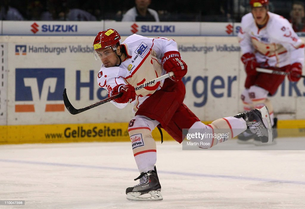 Andre Reiss of Hannover skates with the puck during the DEL match between Hamburg Freezers and Hannover Scorpions at the O2 World Arena on March 11...