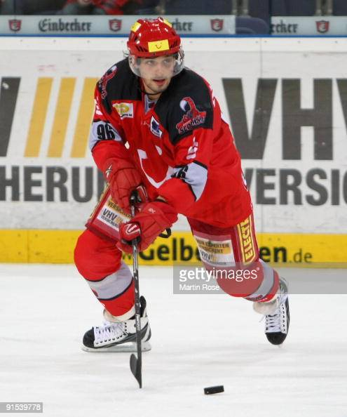 Andre Reiss of Hannover skates with the puck during the DEL match between Hannover Scorpions and Adler Mannheim at the TUI Arena on October 6 2009 in...