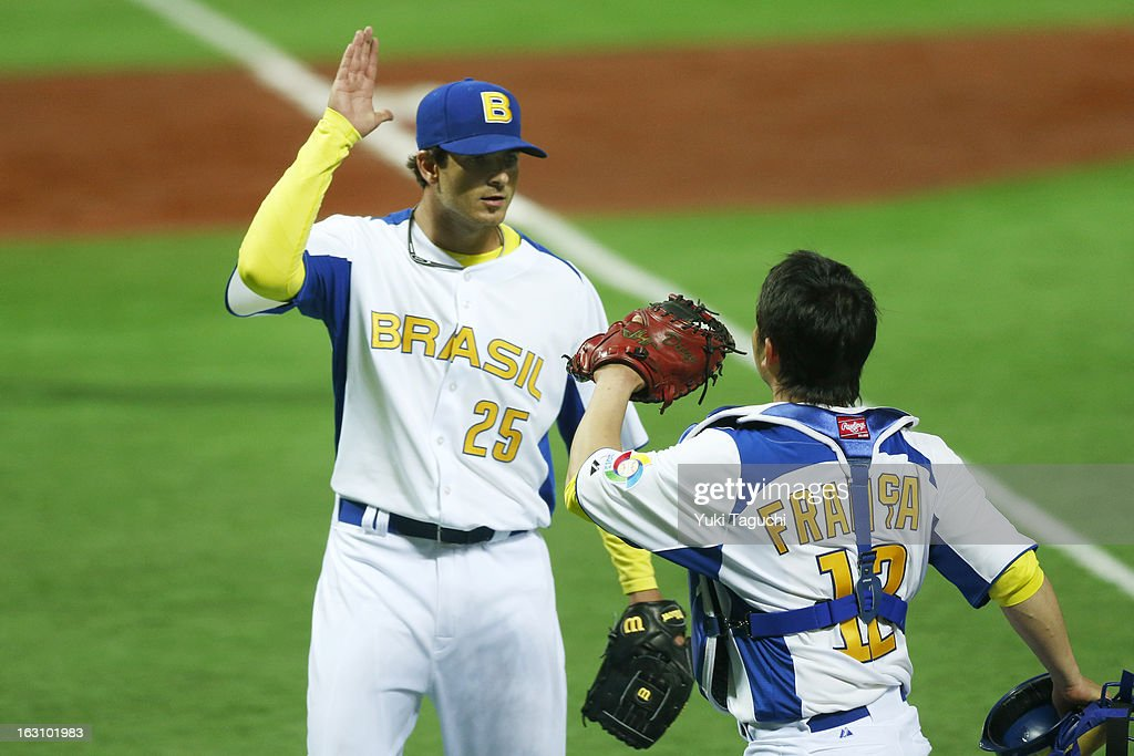 Andre Rienzo #25 and Diego Franca #12 of Team Brazil hi-five during Pool A, Game 2 between Team Cuba and Team Brazil during the first round of the 2013 World Baseball Classic at the Fukuoka Yahoo! Japan Dome on Sunday, March 3, 2013 in Fukuoka, Japan.