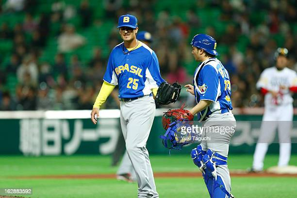 Andre Rienzo and Diego Franca of Team Brazil meet on the mound during the World Baseball Classic exhibition game against the SoftBank Hawks at the...