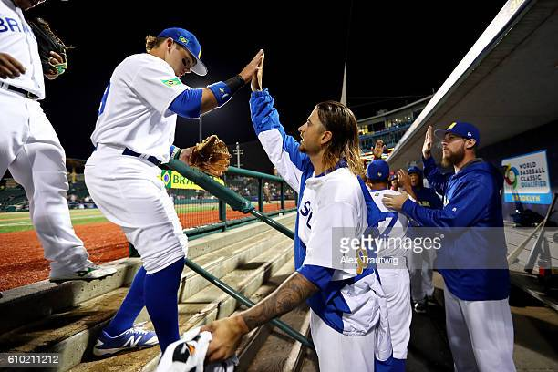 Andre Rienzo of Team Brazil greets teammates as they come back to the dugout during Game 5 of the 2016 World Baseball Classic Qualifier at MCU Park...