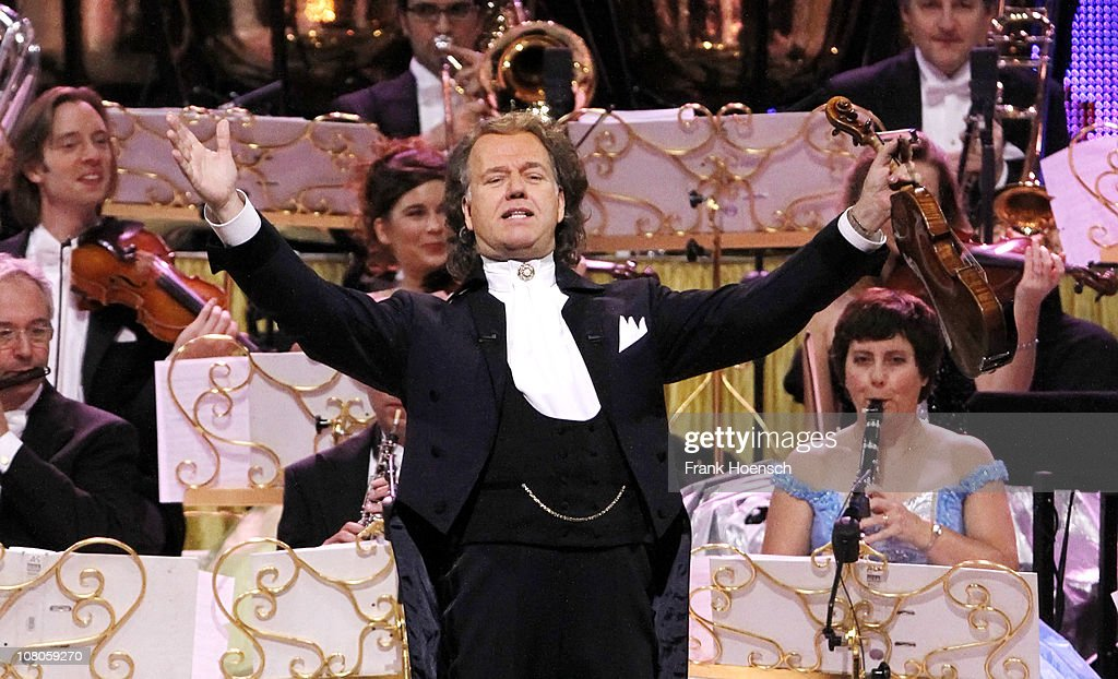 <a gi-track='captionPersonalityLinkClicked' href=/galleries/search?phrase=Andre+Rieu&family=editorial&specificpeople=1016048 ng-click='$event.stopPropagation()'>Andre Rieu</a> and his Johann Strauss Orchestra perform live during a concert at the O2 World on January 15, 2011 in Berlin, Germany.
