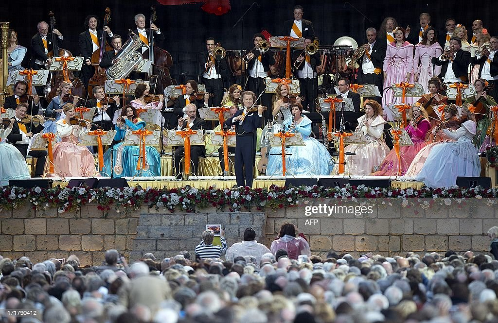Andre Rieu and his orchestra perform at the Vrijthof square in central Maastricht, on June 28, 2013. The world famous violinist and conductor will give 8 concerts between June 28 and July 14. AFP PHOTO / ANP / KIPPA MARCEL VAN HOORN netherlands out