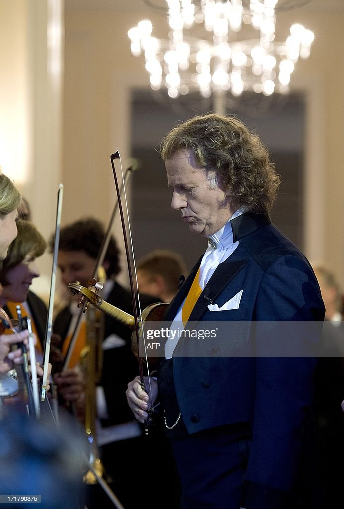 Andre Rieu concentrates prior to his first concert at the Vrijthof square in central Maastricht, on June 28, 2013. The world famous violinist and conductor will give 8 concerts between June 28 and July 14. netherlands out