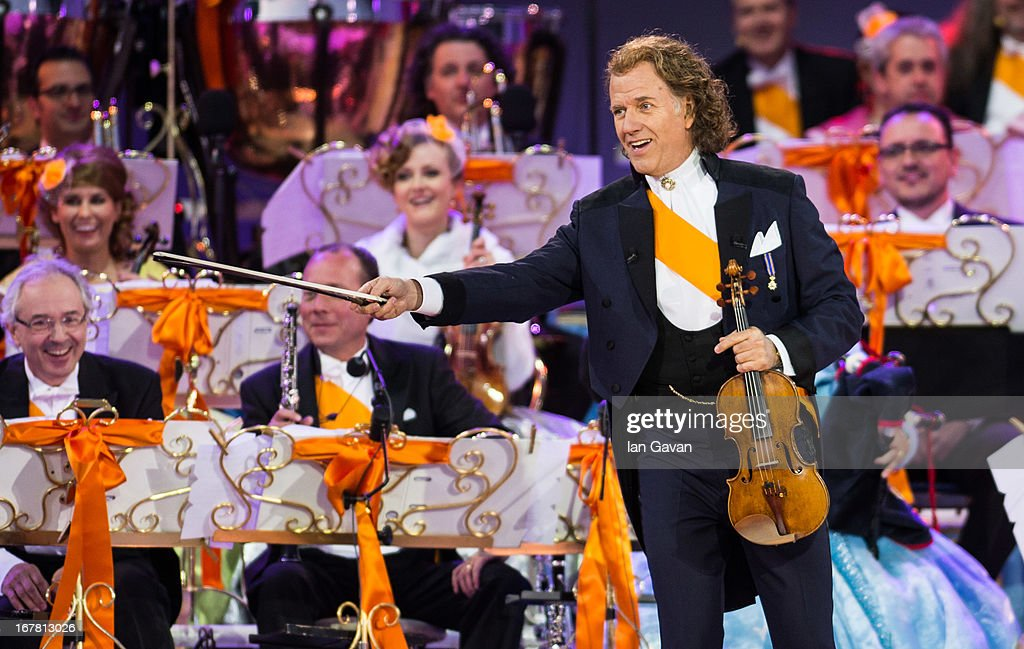 Andre Rieu performs on stage at Museumplien during the inauguration of King Willem Alexander of the Netherlands as Queen Beatrix of the Netherlands abdicates on April 30, 2013 in Amsterdam, Netherlands.