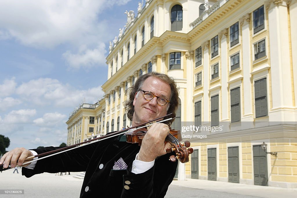 <a gi-track='captionPersonalityLinkClicked' href=/galleries/search?phrase=Andre+Rieu&family=editorial&specificpeople=1016048 ng-click='$event.stopPropagation()'>Andre Rieu</a> plays his violin for the media in front of the Schoenbrunn Castle on May 28, 2010 in Vienna, Austria.