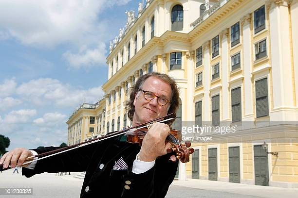 Andre Rieu plays his violin for the media in front of the Schoenbrunn Castle on May 28 2010 in Vienna Austria