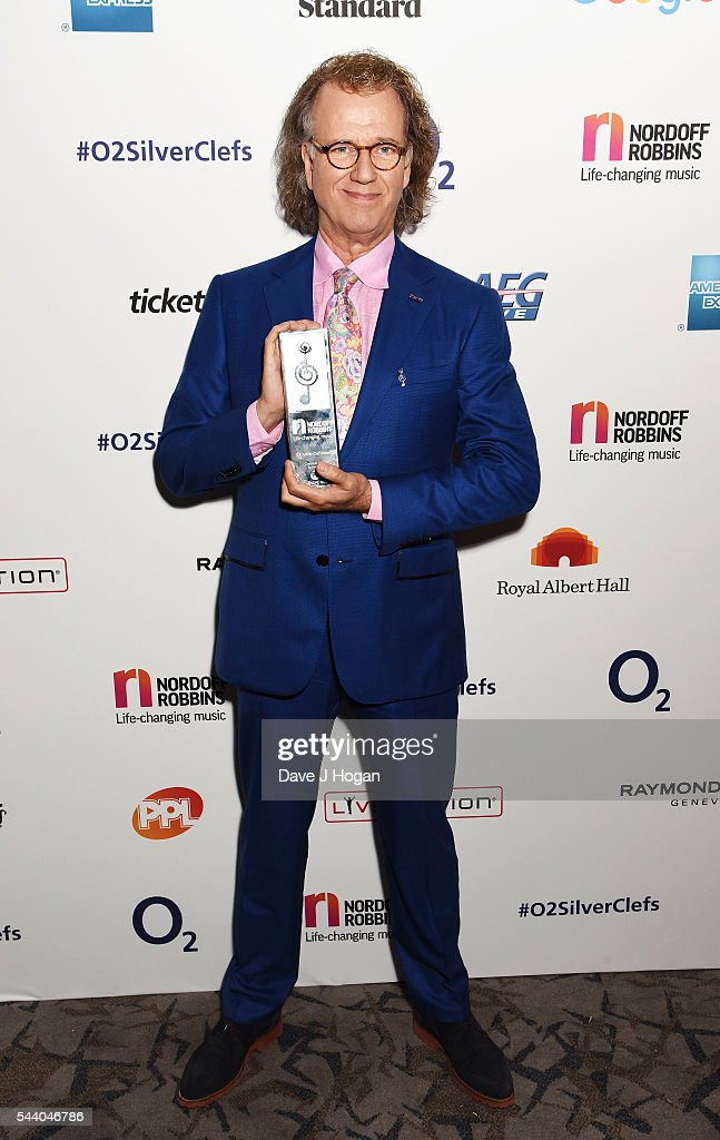 <a gi-track='captionPersonalityLinkClicked' href=/galleries/search?phrase=Andre+Rieu&family=editorial&specificpeople=1016048 ng-click='$event.stopPropagation()'>Andre Rieu</a> poses with the PPL Classical Award during the Nordoff Robbins O2 Silver Clef Awards on July 1, 2016 in London, United Kingdom.