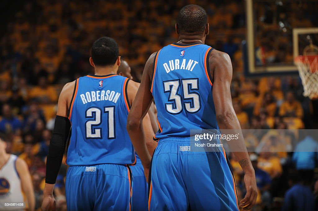 Andre Roberson #21 and <a gi-track='captionPersonalityLinkClicked' href=/galleries/search?phrase=Kevin+Durant&family=editorial&specificpeople=3847329 ng-click='$event.stopPropagation()'>Kevin Durant</a> #35 of the Oklahoma City Thunder during Game Five of the Western Conference Finals against the Golden State Warriors during the 2016 NBA Playoffs on May 26, 2016 at ORACLE Arena in Oakland, California.