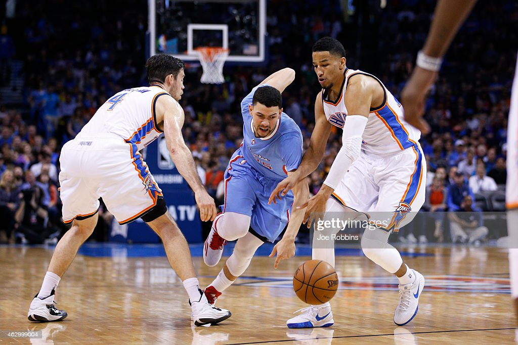 Andre Roberson #21 and <a gi-track='captionPersonalityLinkClicked' href=/galleries/search?phrase=Nick+Collison&family=editorial&specificpeople=202843 ng-click='$event.stopPropagation()'>Nick Collison</a> #4 of the Oklahoma City Thunder defend against <a gi-track='captionPersonalityLinkClicked' href=/galleries/search?phrase=Austin+Rivers&family=editorial&specificpeople=7117574 ng-click='$event.stopPropagation()'>Austin Rivers</a> #25 of the Los Angeles Clippers during the game at Chesapeake Energy Arena on February 8, 2015 in Oklahoma City, Oklahoma. The Thunder defeated the Clippers 131-108.