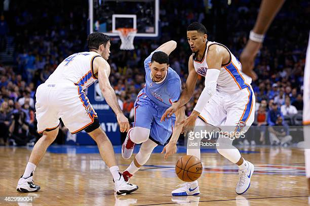 Andre Roberson and Nick Collison of the Oklahoma City Thunder defend against Austin Rivers of the Los Angeles Clippers during the game at Chesapeake...