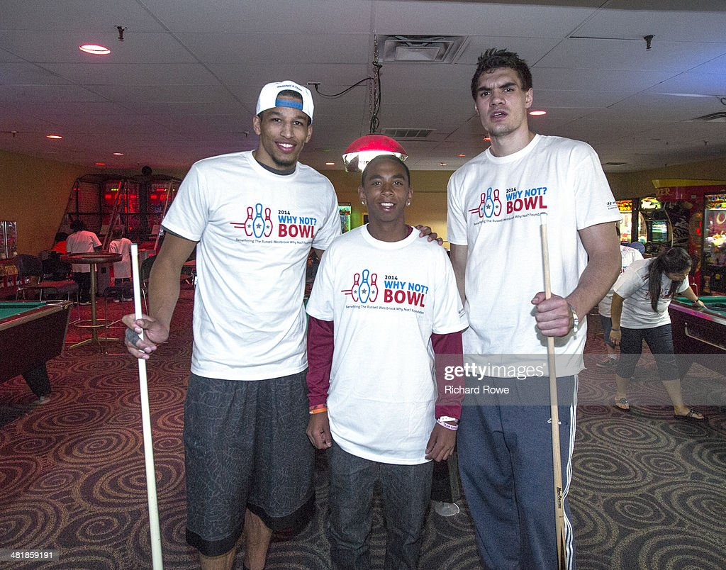 Andre Roberson #21 and Steven Adams ##12 join Russell Westbrook #0 of the Oklahoma City Thunder at his annual Why Not Foundation fundraiser to benefit the Boys and Girls Club at AMC Boulevard Bowl in Edmond, Oklahoma.