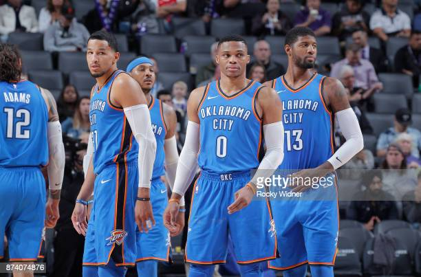 Andre Roberson Carmelo Anthony Russell Westbrook and Paul George of the Oklahoma City Thunder face the Sacramento Kings on November 7 2017 at Golden...