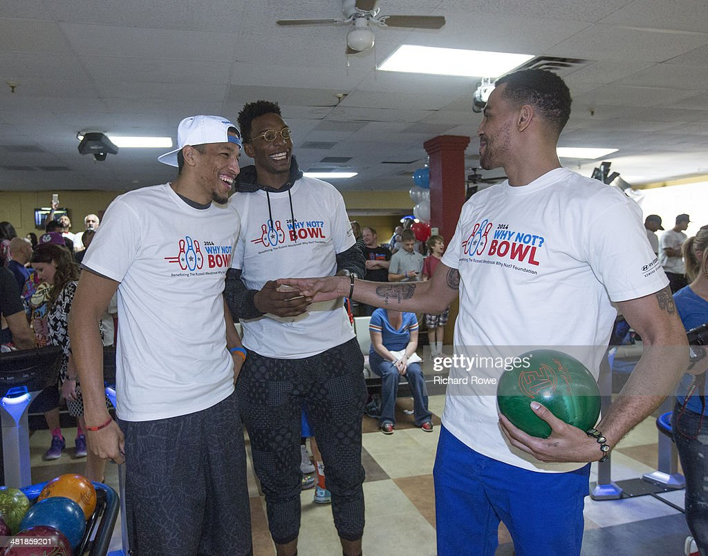 Andre Roberson #21, Hasheem Thabeet #34 and Thabo Sefolosha #2 join Russell Westbrook #0 of the Oklahoma City Thunder at his annual Why Not Foundation fundraiser to benefit the Boys and Girls Club at AMC Boulevard Bowl in Edmond, Oklahoma.