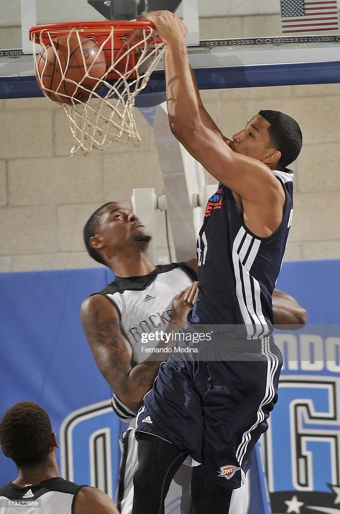 Andre Roberson #21 of the Oklahoma City Thunder dunks the ball during the 2013 Southwest Airlines Orlando Pro Summer League game between the Oklahoma City Thunder and the Houston Rockets on July 12, 2013 at Amway Center in Orlando, Florida.