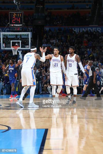Andre Roberson of the Oklahoma City Thunder gives high five to Carmelo Anthony of the Oklahoma City Thunder during the game against the LA Clippers...
