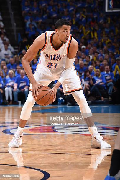 Andre Roberson of the Oklahoma City Thunder handles the ball against the Golden State Warriors in Game Three of the Western Conference Finals during...