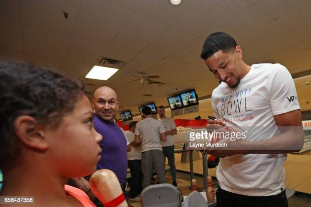 Andre Roberson of the Oklahoma City Thunder signs autographs during Russell Westbrook's 7th annual Why Not Foundation bowling event on March 24 2017...