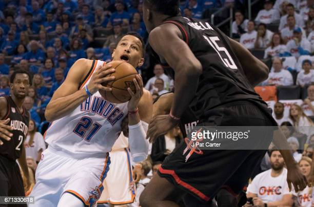 Andre Roberson of the Oklahoma City Thunder tries to drive past Clint Capela of the Houston Rockets during the second half of Game Three in the 2017...
