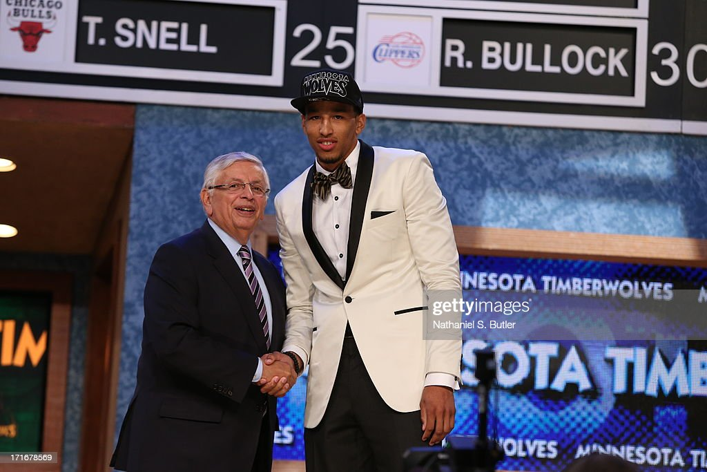 Andre Roberson shakes hands with NBA Commissioner, David Stern after being selected number twent sixth overall by the Minnesota Timberwolves during the 2013 NBA Draft on June 27, 2013 at Barclays Center in Brooklyn, New York.