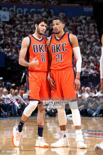 Andre Roberson talks with Alex Abrines of the Oklahoma City Thunder during the game against the Houston Rockets in Game Four during the Western...