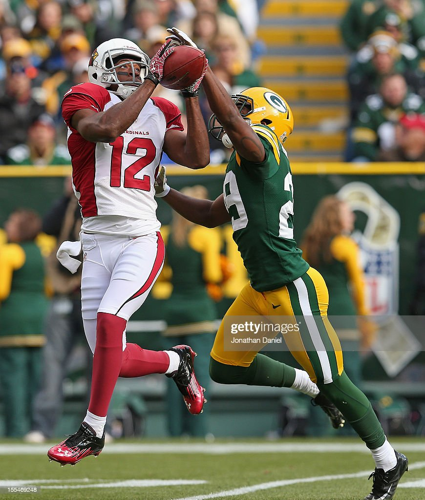 Andre Roberts #12 of the Arizona Cardinals catches a pass for a first down in front of Casey Hayward #29 of the Green Bay Packers at Lambeau Field on November 4, 2012 in Green Bay, Wisconsin.
