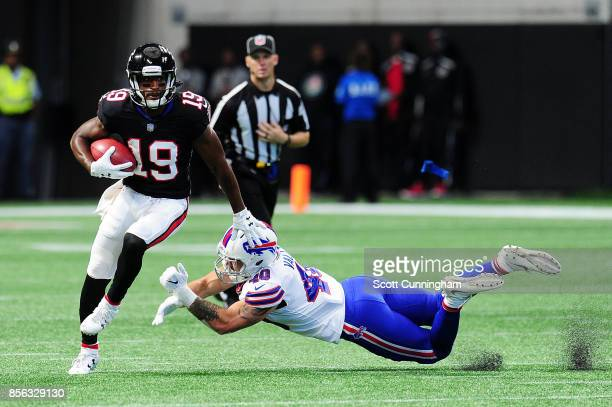 Andre Roberts of the Atlanta Falcons stiff arms Tanner Vallejo of the Buffalo Bills during the first half at MercedesBenz Stadium on October 1 2017...