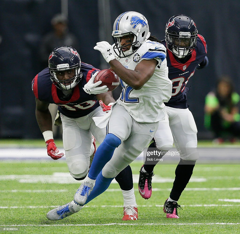 Andre Roberts #12 of the Detroit Lions rushes past Alfred Blue #28 of the Houston Texans and Charles James #31 at NRG Stadium on October 30, 2016 in Houston, Texas.
