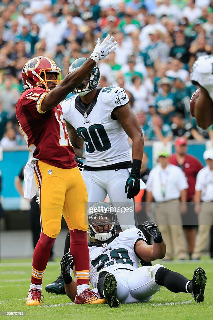 Andre Roberts #12 of the Washington Redskins reacts fter a first down catch in the first quarter of the game against Marcus Smith #90 of the Philadelphia Eagles and <a gi-track='captionPersonalityLinkClicked' href=/galleries/search?phrase=Earl+Wolff&family=editorial&specificpeople=6379729 ng-click='$event.stopPropagation()'>Earl Wolff</a> #28 at Lincoln Financial Field on September 21, 2014 in Philadelphia, Pennsylvania.