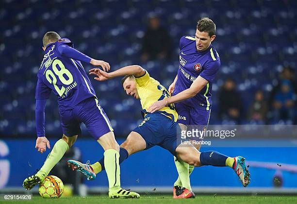 Andre Romer of FC Midtjylland and Kamil Wilczek of Brondby IF and Jonas Borring of FC Midtjylland compete for the ball during the Danish Alka...