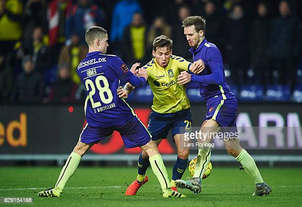 Andre Romer of FC Midtjylland Andrew Hjulsager of Brondby IF and Kian Hansen of FC Midtjylland compete for the ball during the Danish Alka Superliga...