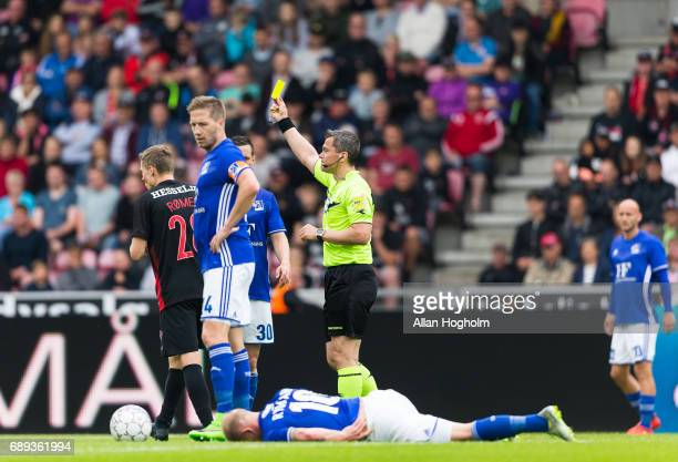 Andre Romer of FC Midtjylland receives a yellow card from Referee Michael Tykgaard during the Danish Alka Superliga match between FC Midtjylland and...