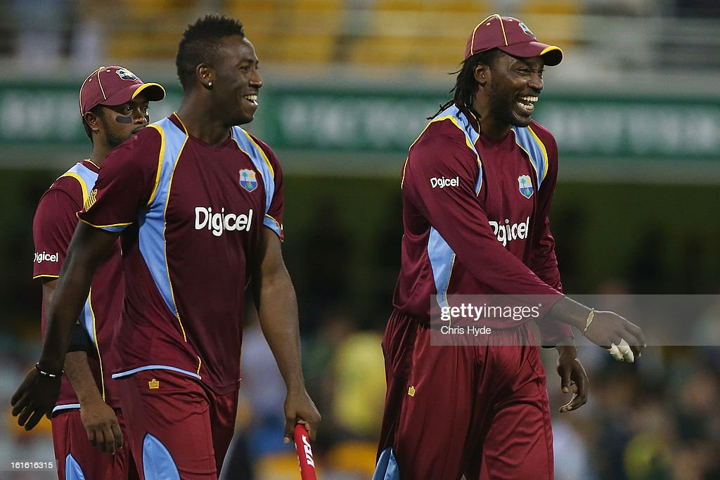 Andre Russell and Chris Gayle of the West Indies celebrate winning the International Twenty20 match between Australia and the West Indies at The Gabba on February 13, 2013 in Brisbane, Australia.