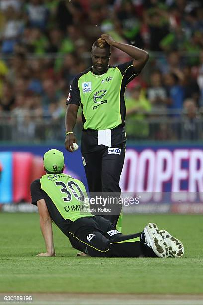 Andre Russell and Pat Cummins of the Thunder looks dejected after Cummins dropped a catch during the Big Bash League match between the Sydney Thunder...