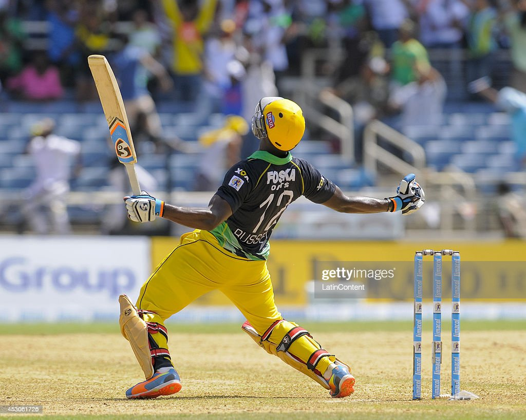 <a gi-track='captionPersonalityLinkClicked' href=/galleries/search?phrase=Andre+Russell&family=editorial&specificpeople=5348594 ng-click='$event.stopPropagation()'>Andre Russell</a> of Jamaica Tallawahs celebrates after hitting the winning runs during a match between Jamaica Tallawahs and Guyana Amazon Warriors as part of week 4 of the Caribbean Premier League 2014 at Sabina Park on August 02, 2014 in Kingston, Jamaica.