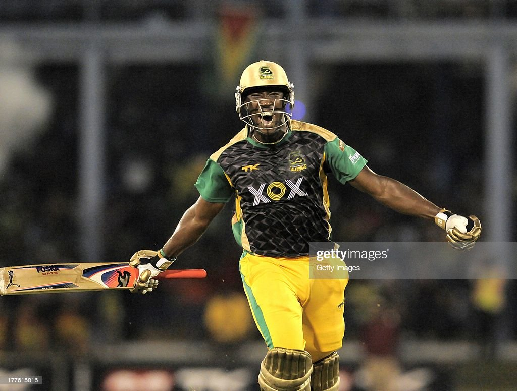 <a gi-track='captionPersonalityLinkClicked' href=/galleries/search?phrase=Andre+Russell&family=editorial&specificpeople=5348594 ng-click='$event.stopPropagation()'>Andre Russell</a> of Jamaica Tallawahs celebrates victory against Guyana Amazon Warriors during the Final of the Caribbean Premier League between Guyana Amazon Warriors v Jamaica Tallawahs at Queens Park Oval on August 24, 2013 in Port of Spain, Trinidad and Tobago.