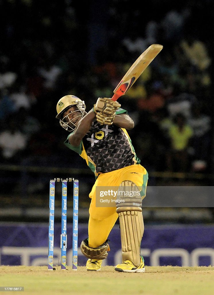 <a gi-track='captionPersonalityLinkClicked' href=/galleries/search?phrase=Andre+Russell&family=editorial&specificpeople=5348594 ng-click='$event.stopPropagation()'>Andre Russell</a> of Jamaica Tallawahs hits a 4 against Guyana Amazon Warriors during the Final of the Caribbean Premier League between Guyana Amazon Warriors v Jamaica Tallawahs at Queens Park Oval on August 24, 2013 in Port of Spain, Trinidad and Tobago.