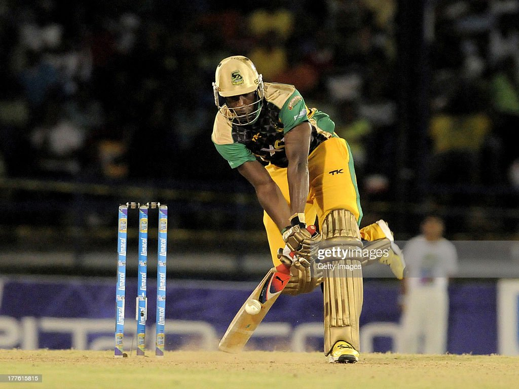 <a gi-track='captionPersonalityLinkClicked' href=/galleries/search?phrase=Andre+Russell&family=editorial&specificpeople=5348594 ng-click='$event.stopPropagation()'>Andre Russell</a> of Jamaica Tallawahs survives a yorker from Guyana Amazon Warriors Lasith Malinga during the Final of the Caribbean Premier League between Guyana Amazon Warriors v Jamaica Tallawahs at Queens Park Oval on August 24, 2013 in Port of Spain, Trinidad and Tobago.