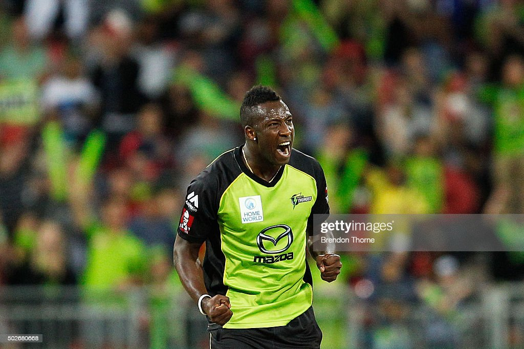 Andre Russell of the Thunder celebrates after claiming the wicket of Brad Hodge of the Strikers during the Big Bash League match between the Sydney Thunder and Adelaide Strikers at Spotless Stadium on December 28, 2015 in Sydney, Australia.