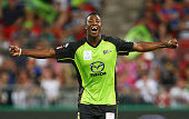 Andre Russell of the Thunder celebrates taking the wicket of Nathan Lyon of the Sixers during the Big Bash League match between the Sydney Thunder...